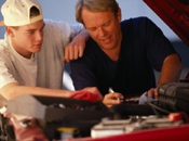 father and son fixing engine car