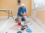 man painting walls home