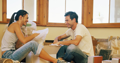couple unpacking home