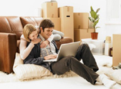 couple with notebook just moved home